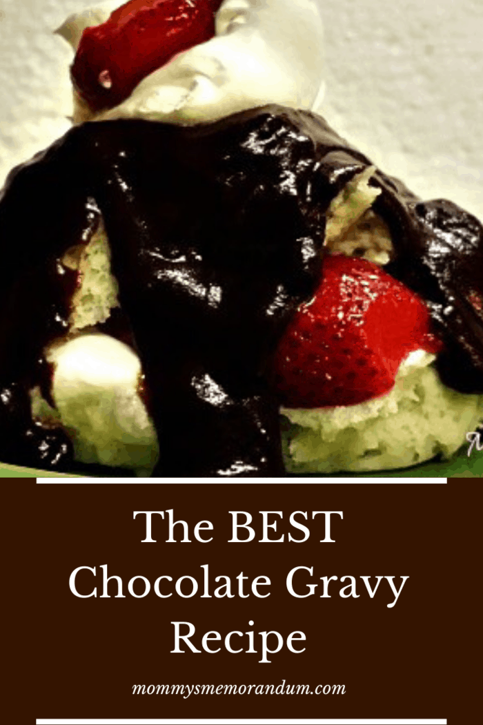 easy chocolate gravy made with ovaltine over a biscuit with strawberry garnish