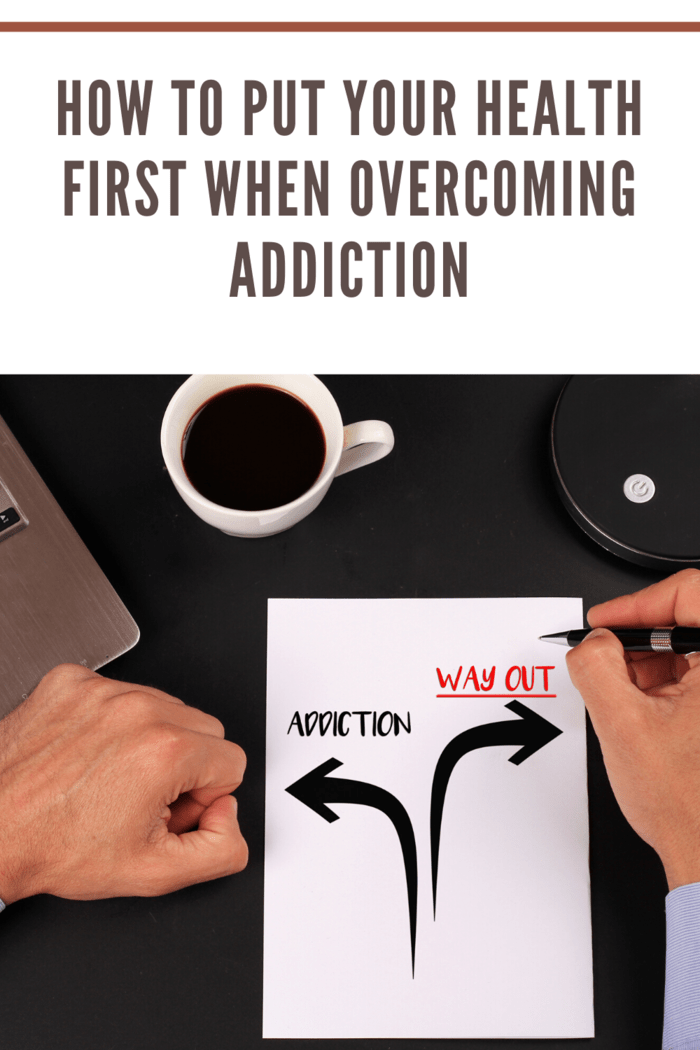 man drawing on paper arrow pointing to addiction and arrow pointing to the right as way out