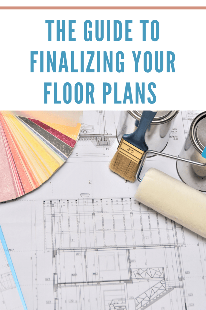 floor plans with paint swatches, paint brush and roller on table
