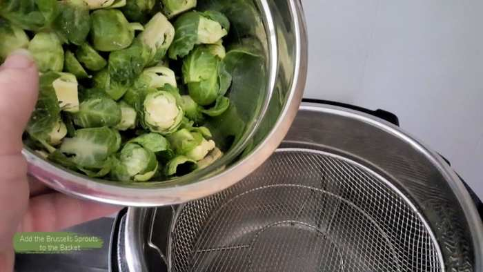 add the seasoned brussels sprouts to the mesh basket