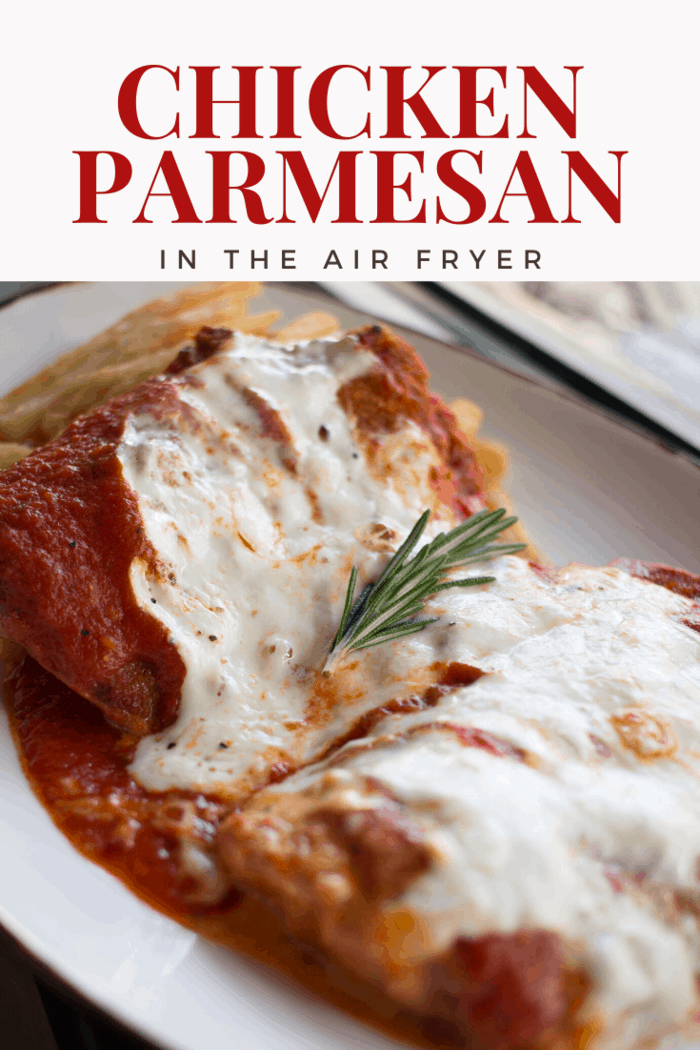 It'll look like you spent hours in the kitchen, but this air fryer parmesan chicken recipe comes together easily with ingredients you probably already have on hand! #airfryerchickenparmesan #chickenparmesan #airfryer #airfryerchicken