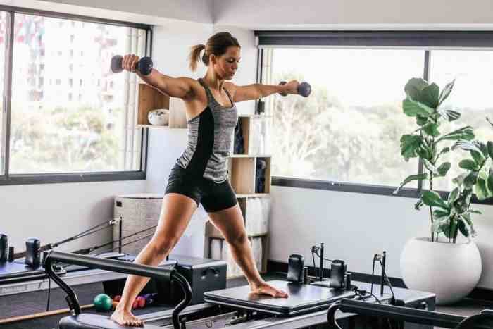 Woman doing Reformer PIlates