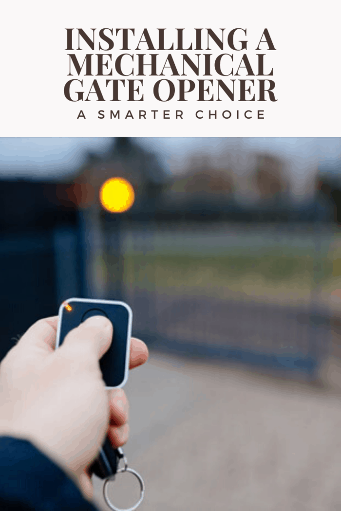 hand pushing automatic gate opener remote to open gate