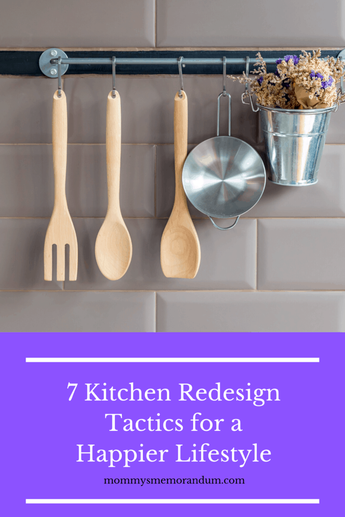 wooden fork spoon and spatula on metal bar against back splash