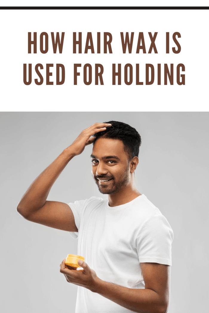 man using hair wax to hold hair