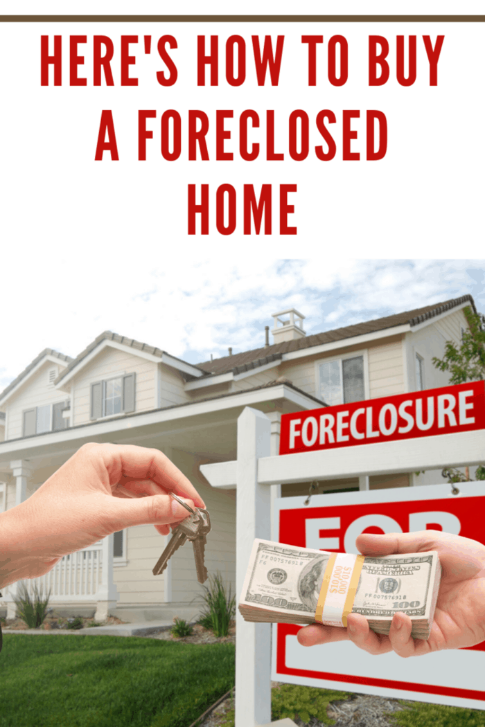 cash and keys in front of foreclosed home with sign