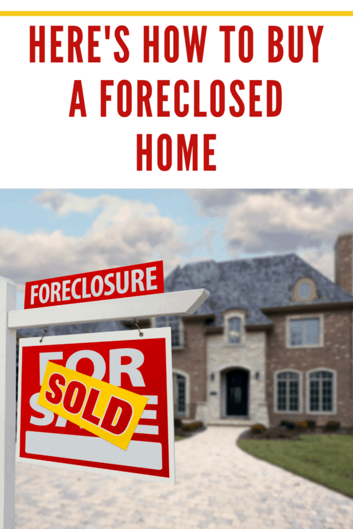 foreclosed home with sold sign