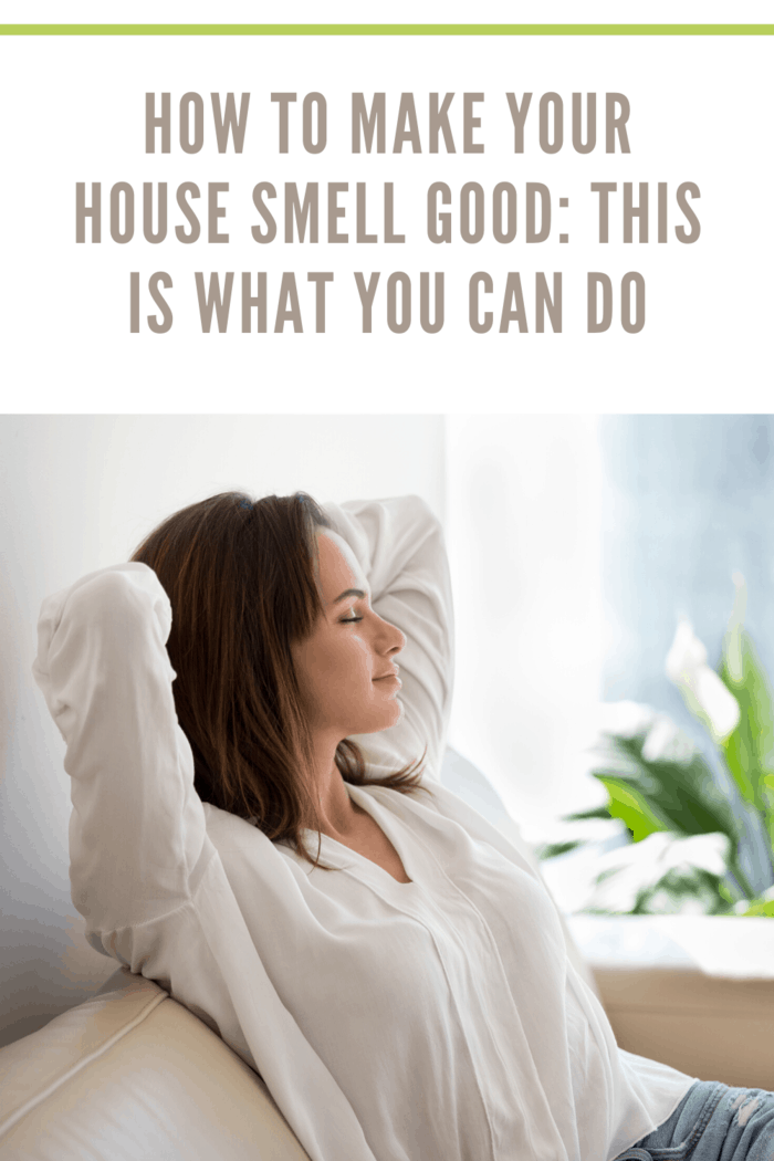 woman relaxing and enjoying that her home smell good