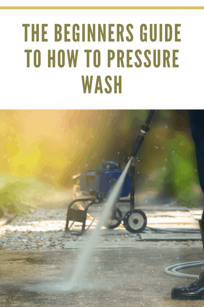 pressure washing with pressure washer in background