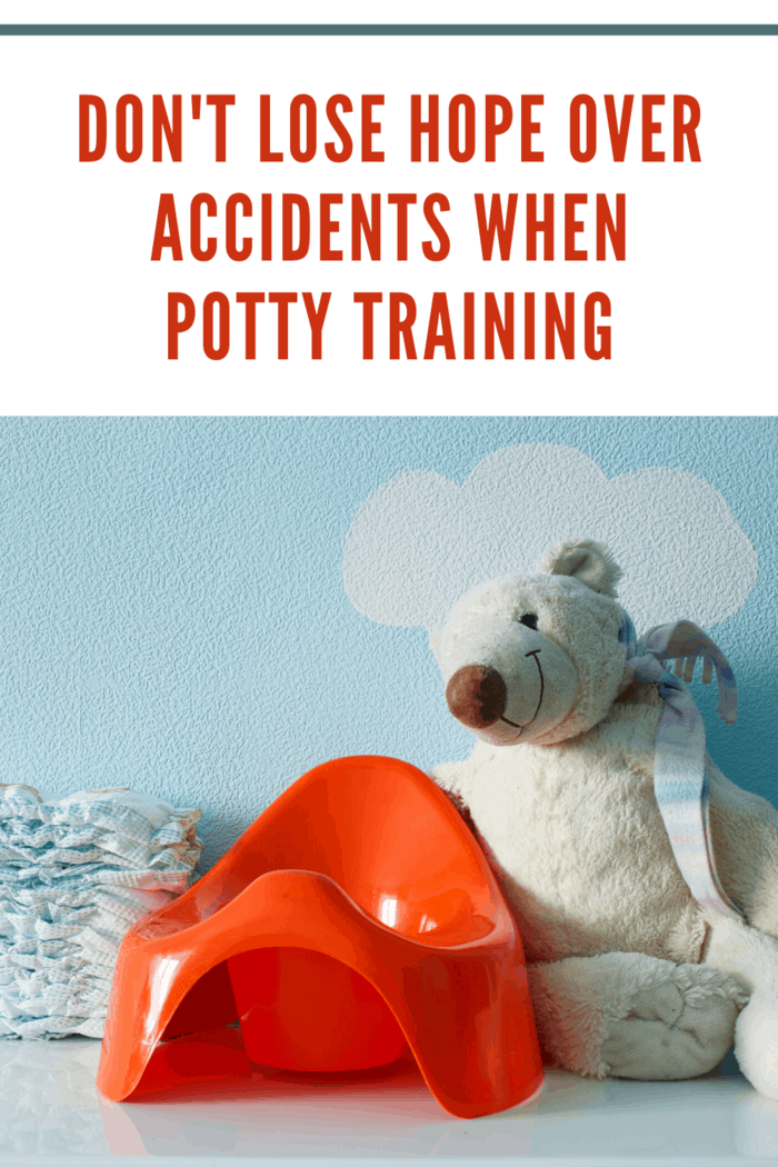 potty training seat, diapers and stuffed bear toilet training for children with autism