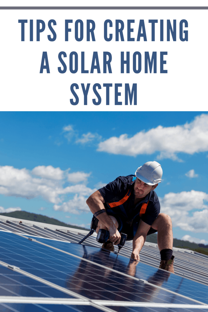 man installing solar panels on house roof