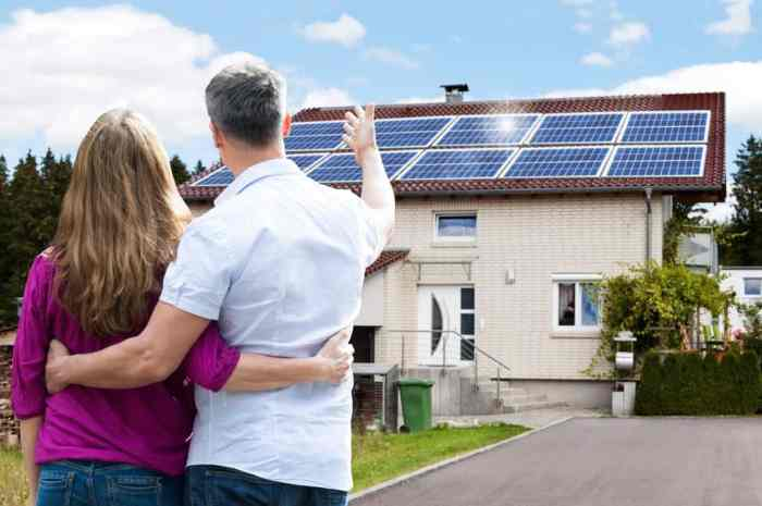 man and woman looking at their new solar home system
