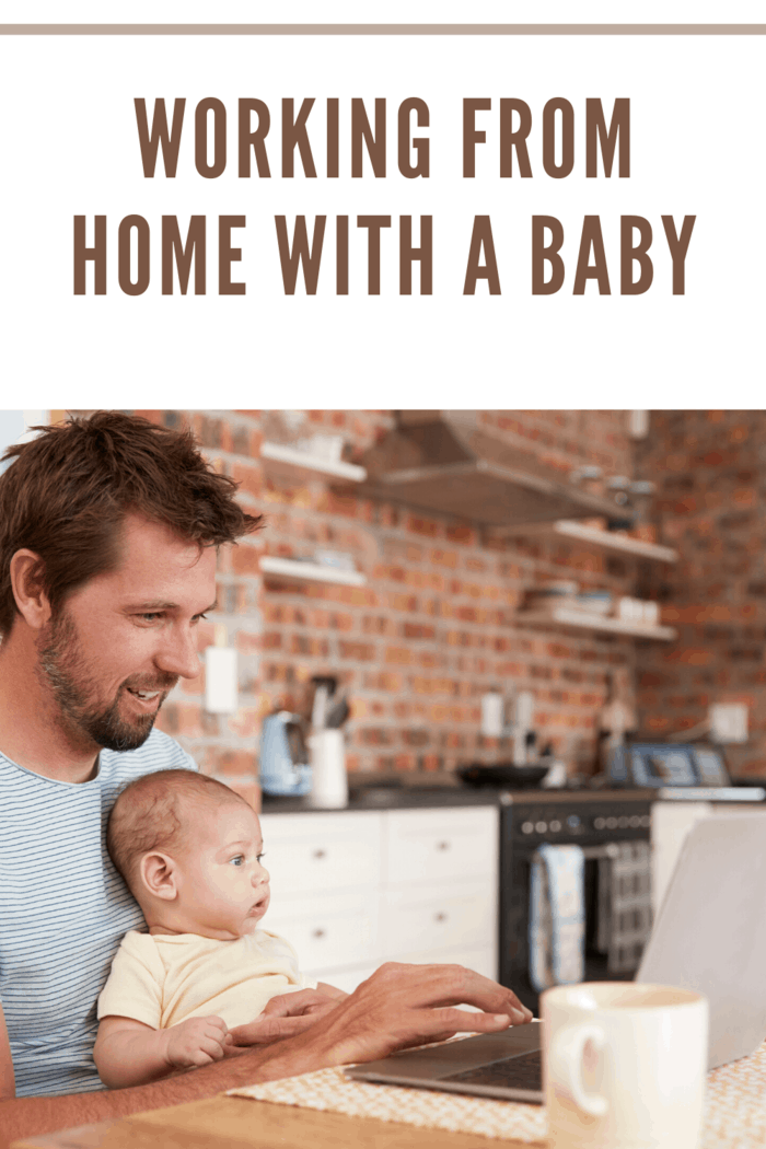 dad with baby on lap working from home