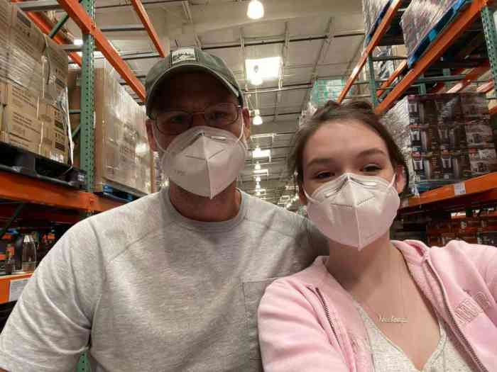 father and daughter wearing kn95 face masks at Costco