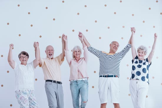 Group of happy seniors holding hands and jumping in the air
