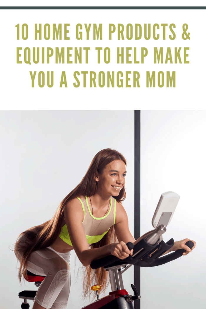 woman with long hair working out at home on stationary bike