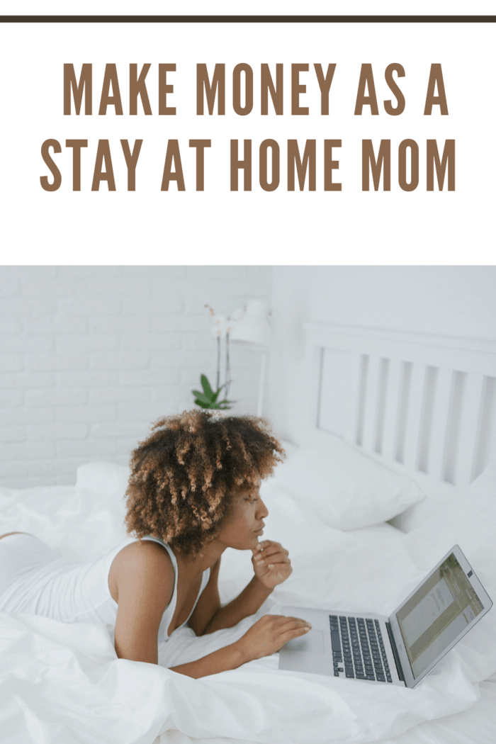 mom laying in bed with computer working from home