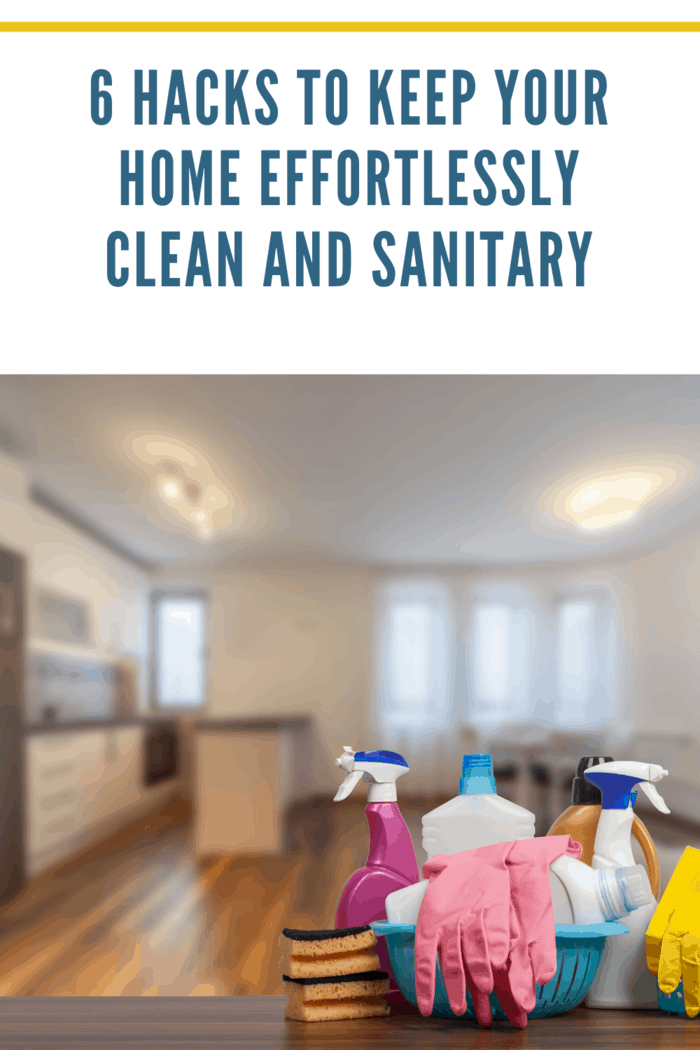 cleaning supplies on counter with clean home in background