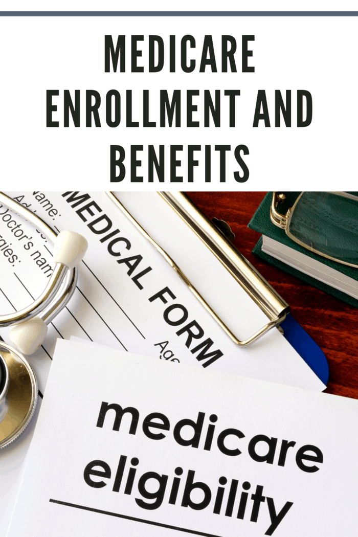 medicare enrollment form on clipboard with medicare eligibility paperwork on top