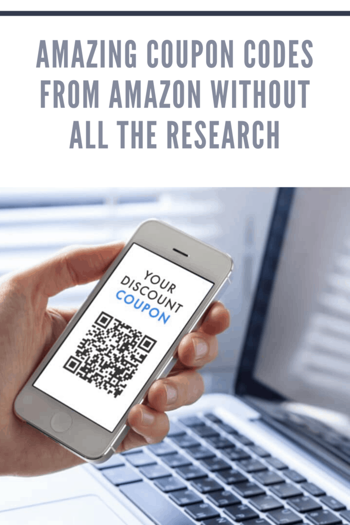 hand holding mobile device with qr code for amazon coupon code
