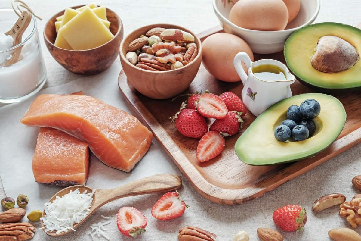clean eating food such as avocado, berries, nuts, and salmon