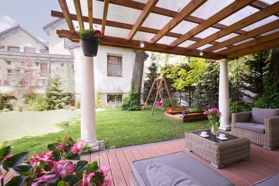 Image of a romantic place to relax in garden under the pergola