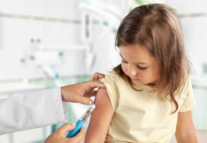 child being given vaccine