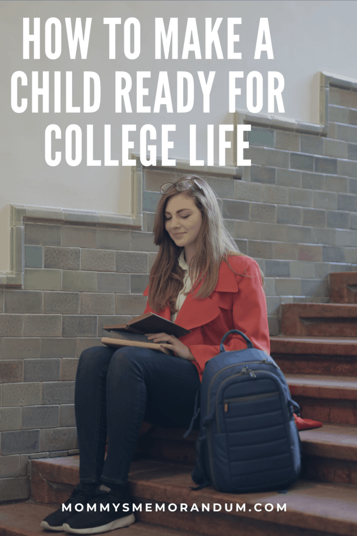 college student sitting on steps studying with book