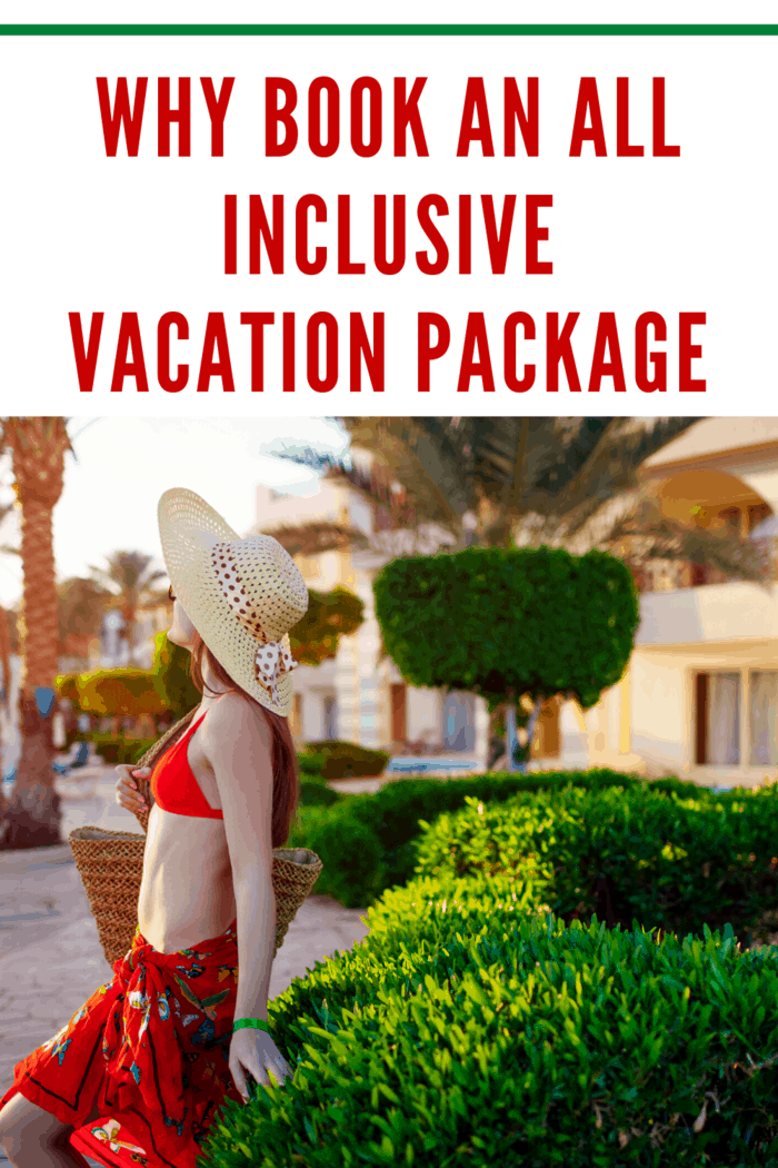 Young woman in bikini and hat walking in hotel garden. Summer vacation. All inclusive.