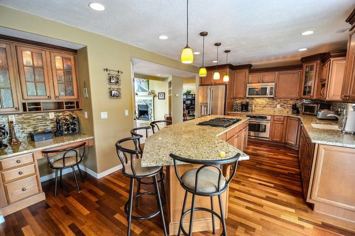 kitchen with hardwood floors and neutral colors