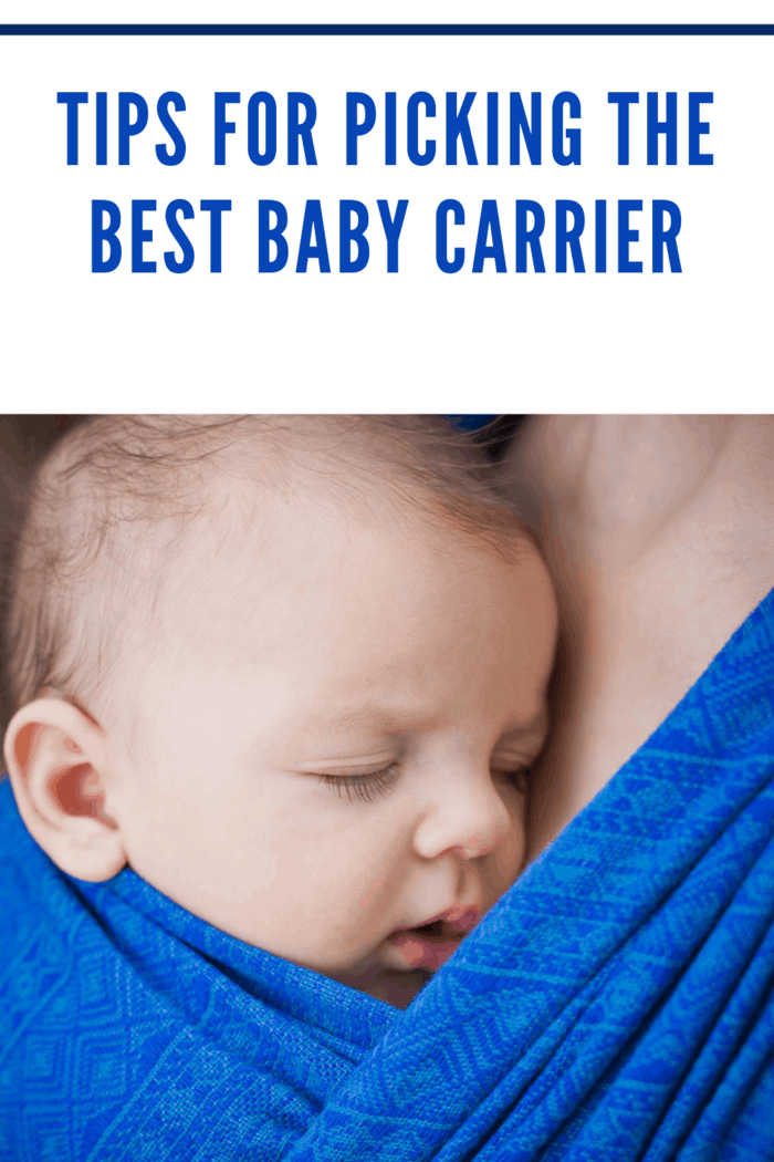 baby in royal blue carrier snuggling mom