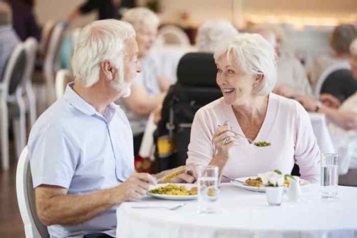 Senior Couple Eating Meal after selecting Retirement Home