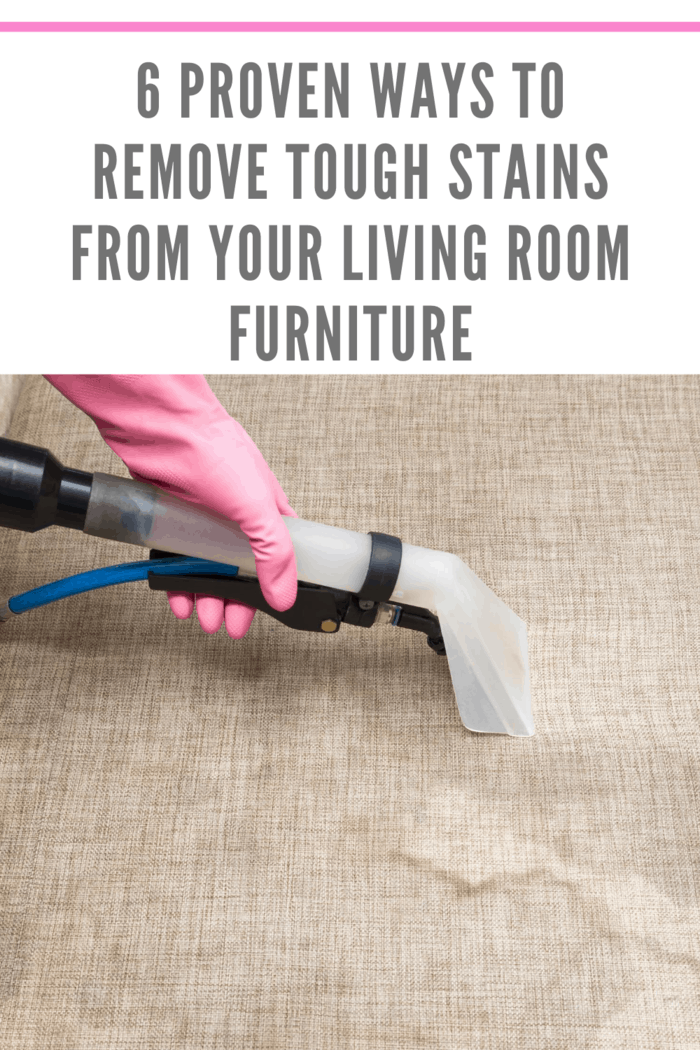 carpet cleaner being used to remove tough stains from living room furniture