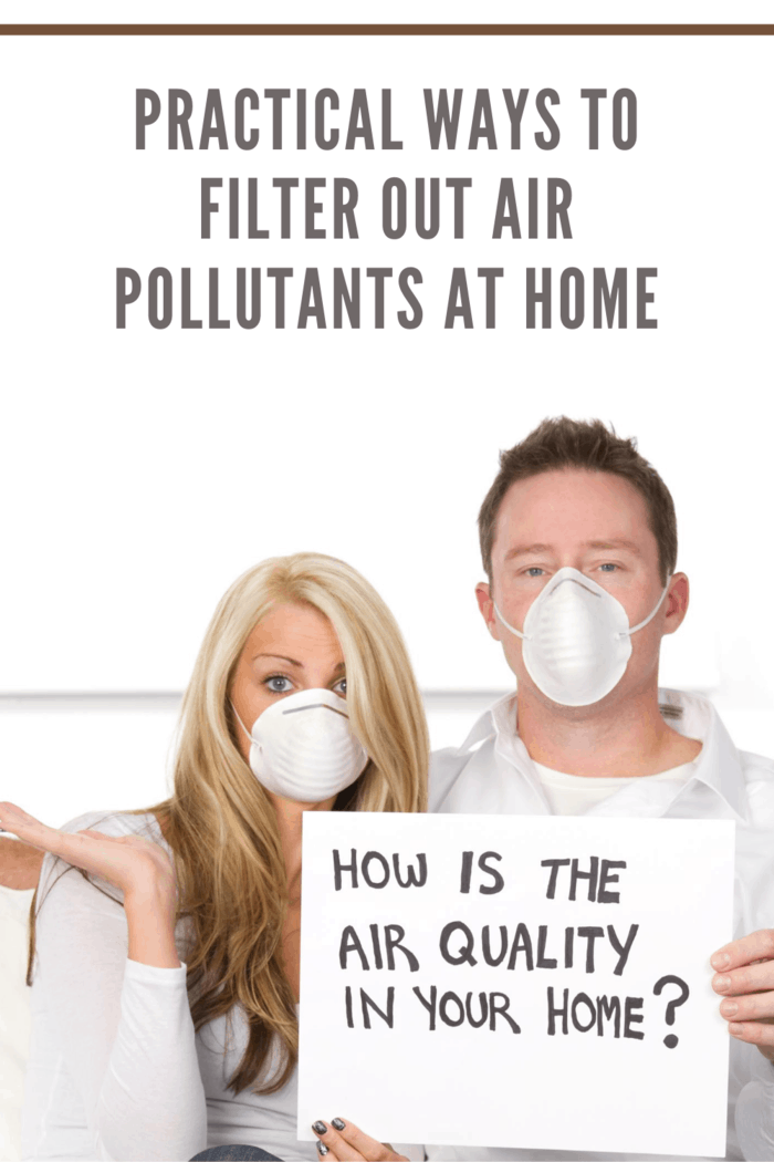 """couple wearing breathing mask and holding sign that says """"how is the air quality in your home?"""" as an carbon monoxide or air pollution in home concept How to Achieve the Best Air Quality Inside Your House"""