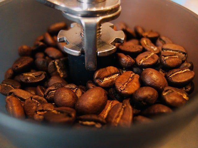 close up of coffee beans in coffee grinder