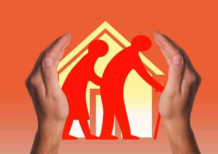 graphic of clipart seniors between hands of adult making decision on placing parents in nursing home