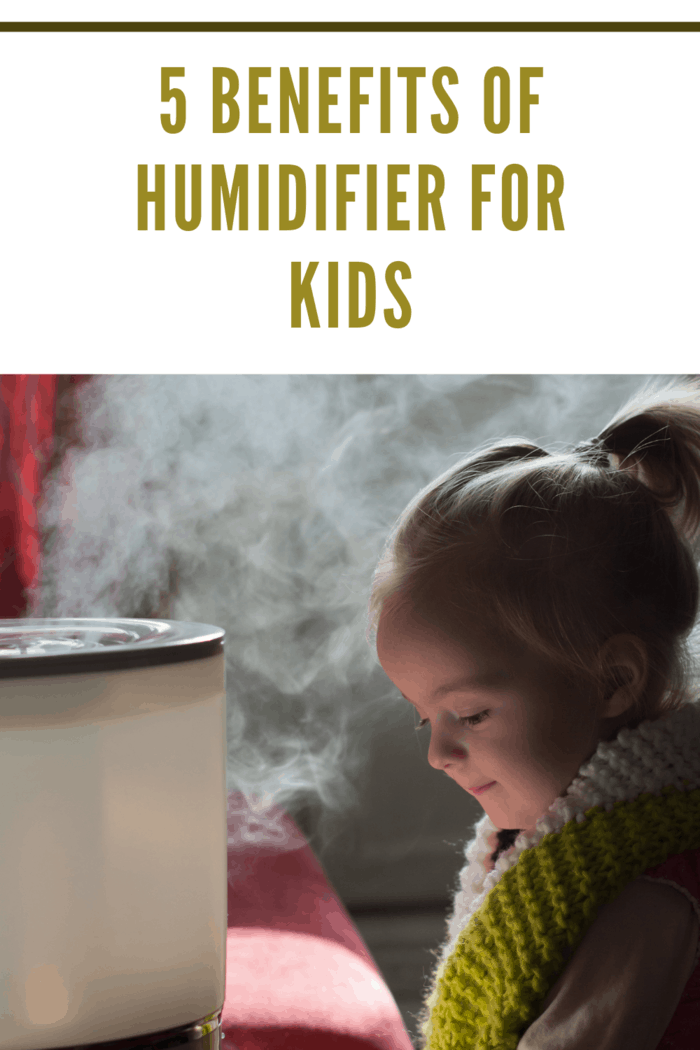 Little girl playing near humidifier reaping the benefits