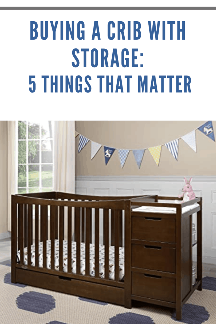 brown crib with storage in nursery in blues and greys