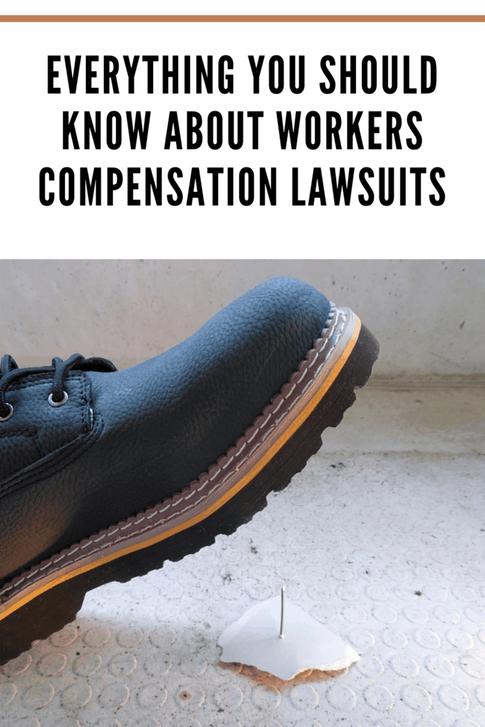 black workboot about to step on piece of drywall with nail sticking up representing a workers compensation lawsuit