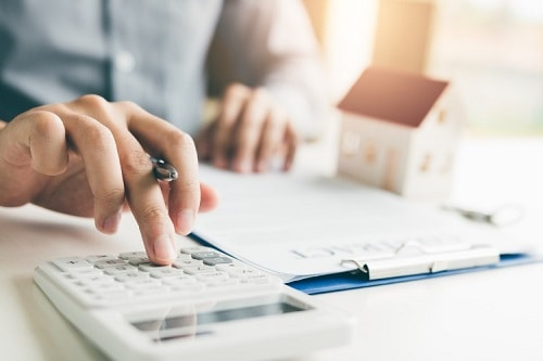 Home agents are using a calculator to calculate the Home Loan EMI