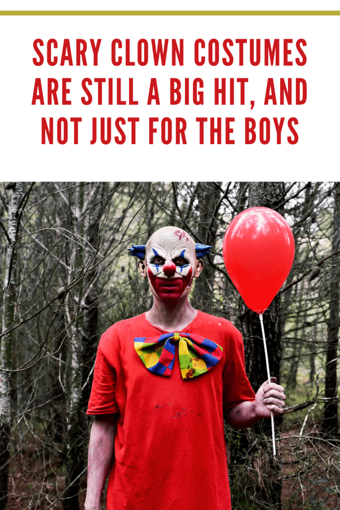 man in scary clown costume standing in woods with red balloon