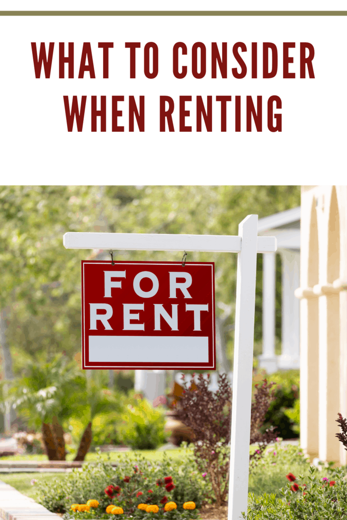 Red For Rent Real Estate Sign in Front House. for those wanting to consider renting