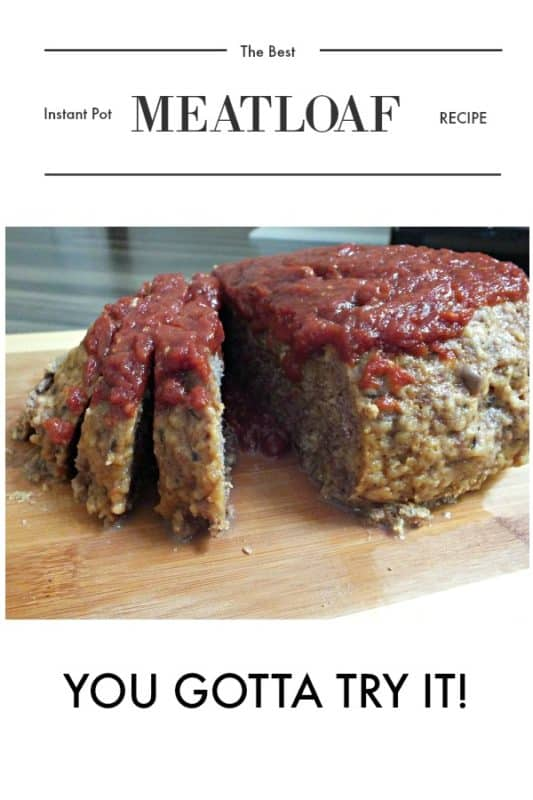 THE BEST INSTANT POT MEATLOAF on a cutting board sliced and showing moist meatloaf topped with ooey gooey sauce