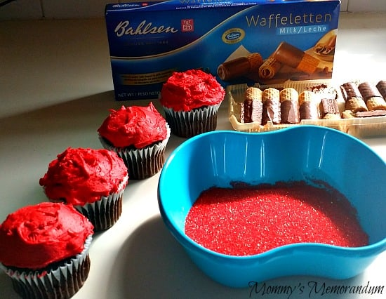 apple cupcakes iced with mound of red icing