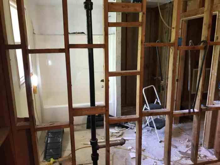 dad's house bathroom demolition looking through kitchen wall