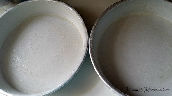 grease and flour your cake pans