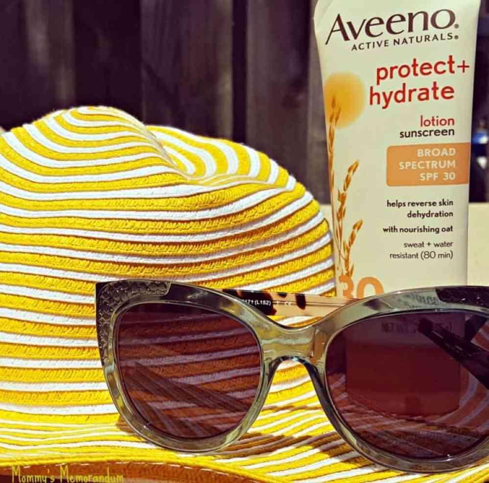 ottica coach prescription sunglasses with yellow hat and aveeno sunscreen