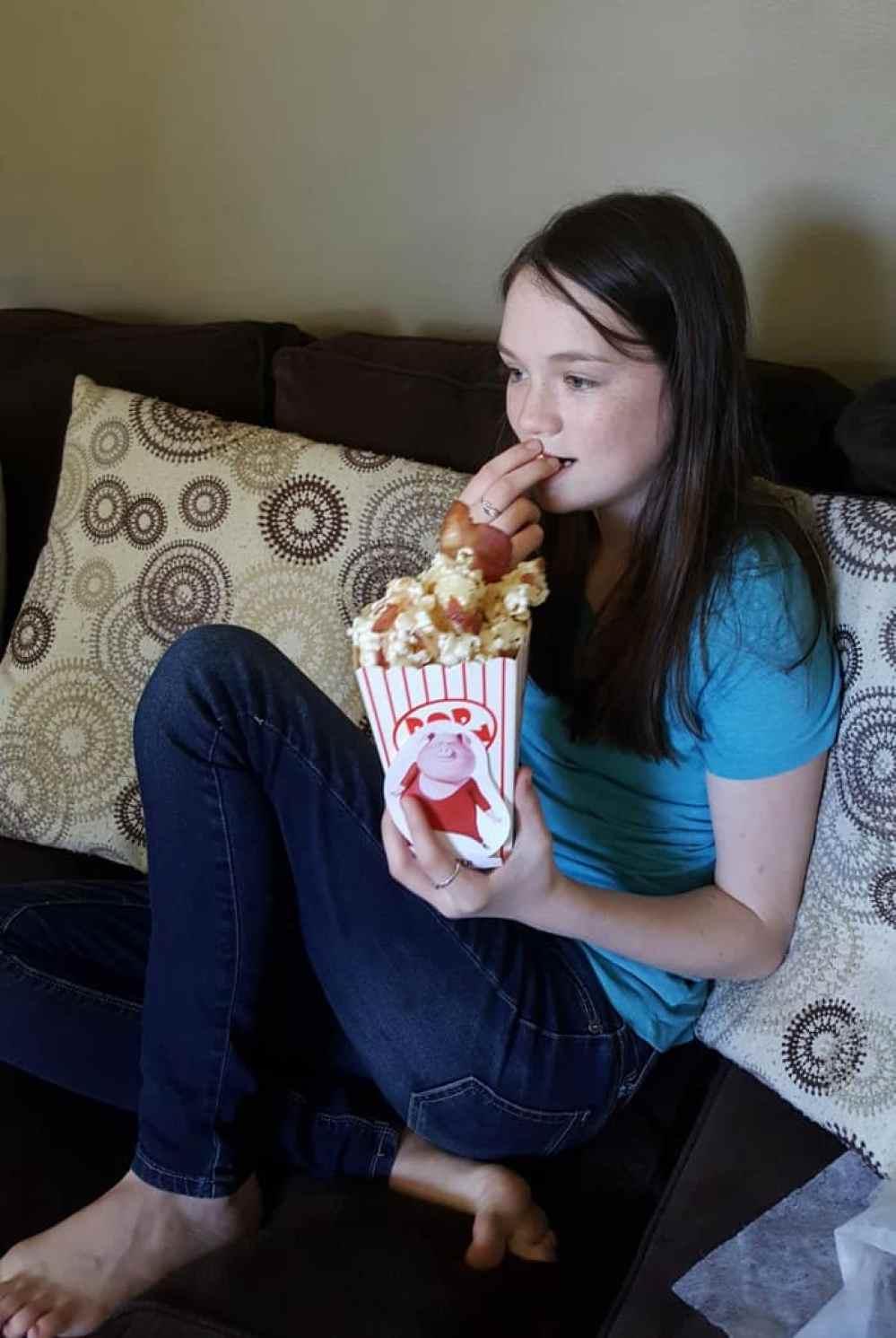 sing movie night eating piggy power popcorn