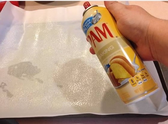 spray parchment paper with pam