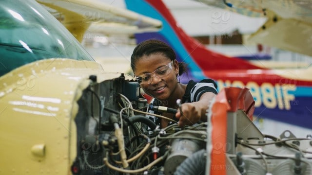 stock-photo-airplane-working-female-aircraft-worker-mechanic-woman-mechanical-job-9ba6bff8-20f1-474d-908c-6d0cddea3477